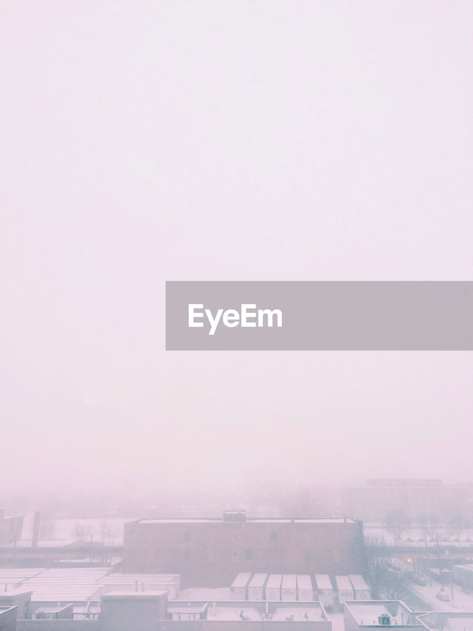 High Angle View Of Buildings During Foggy Weather