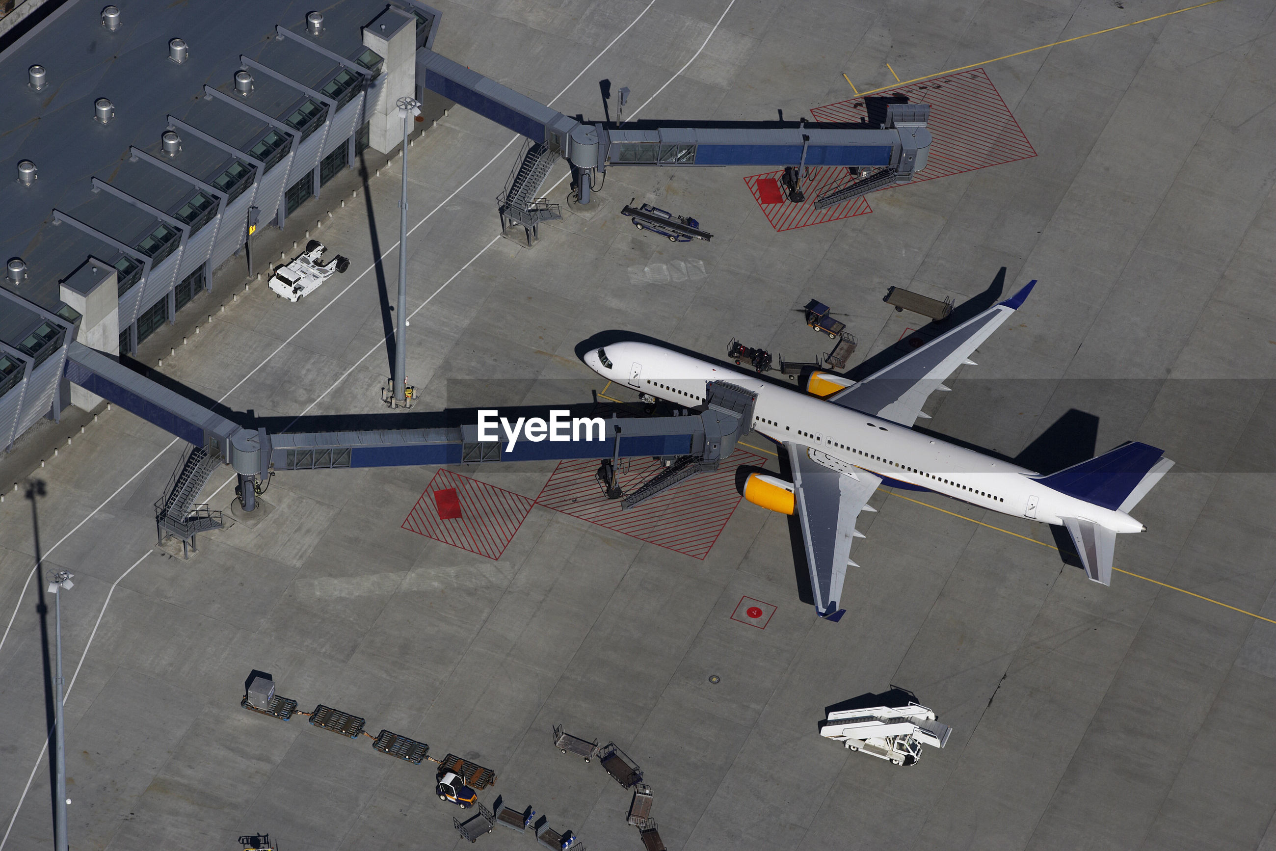 HIGH ANGLE VIEW OF AIRPLANE FLYING OVER AIRPORT
