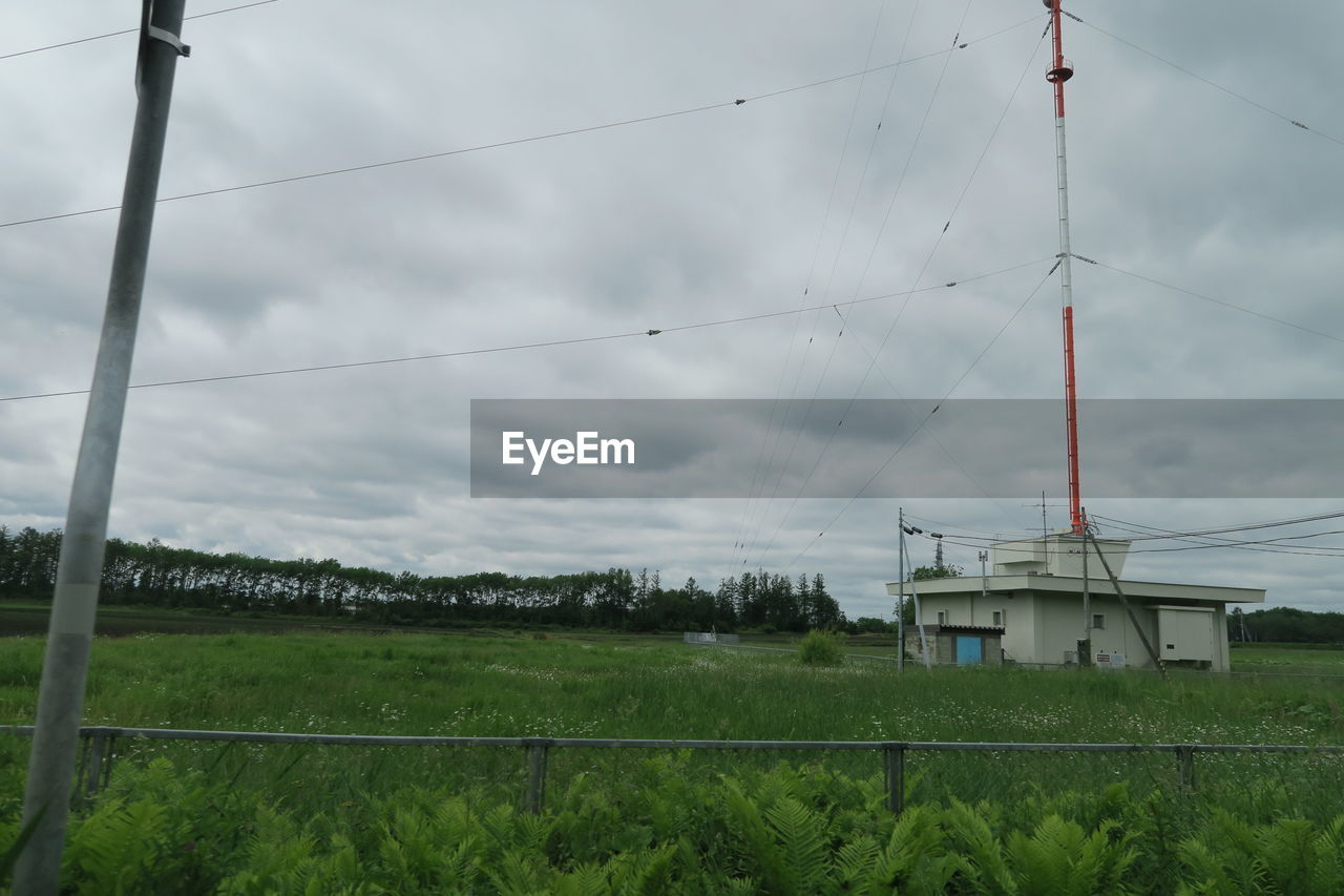 built structure, architecture, building exterior, sky, cable, cloud - sky, nature, no people, electricity, technology, building, day, fuel and power generation, plant, grass, land, power line, outdoors, environment, field, power supply