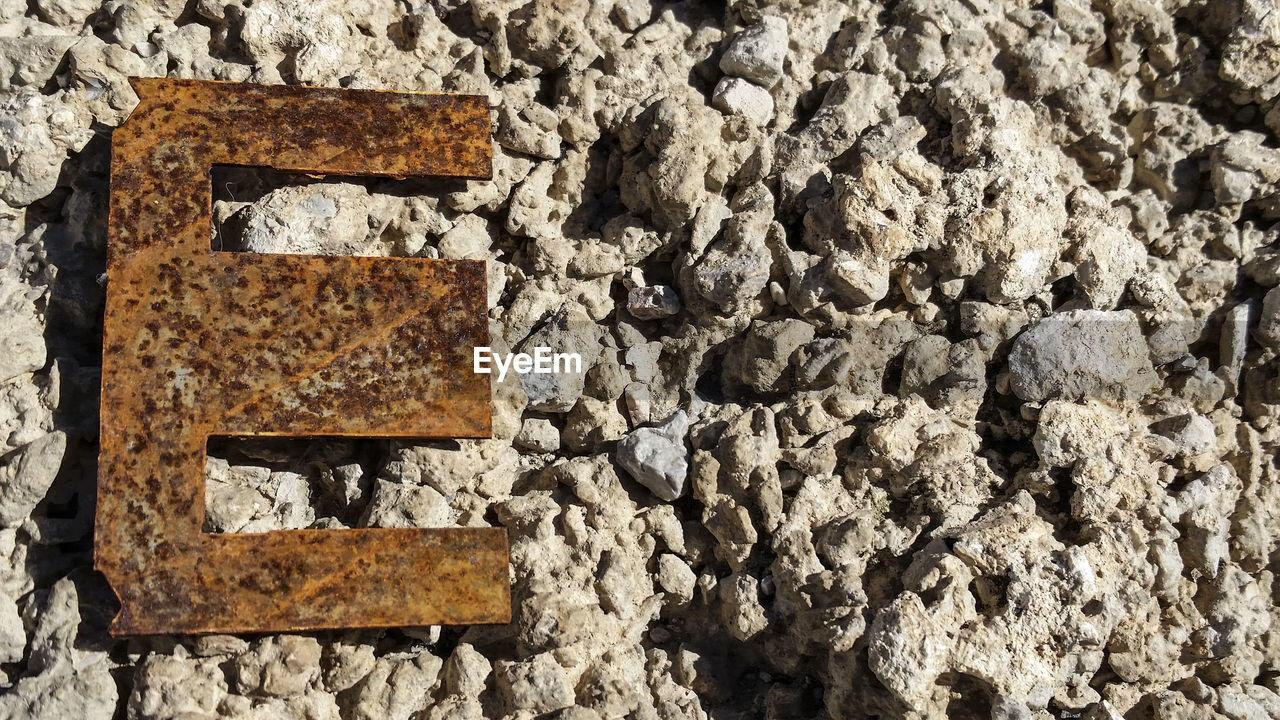 Rusty Letter E On Stone Wall