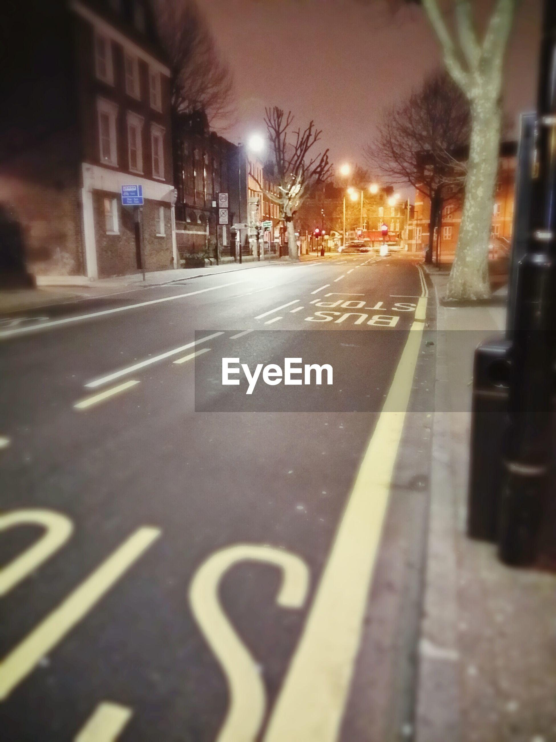 STREET LIGHT ON ROAD AT NIGHT