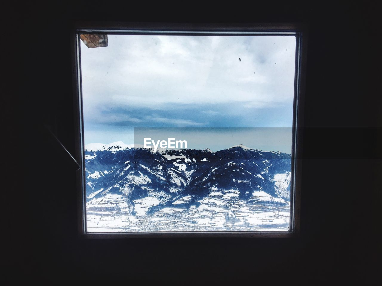 window, mountain, snow, winter, sky, weather, nature, indoors, no people, day, cloud - sky, cold temperature, beauty in nature, scenics, landscape, tree, close-up