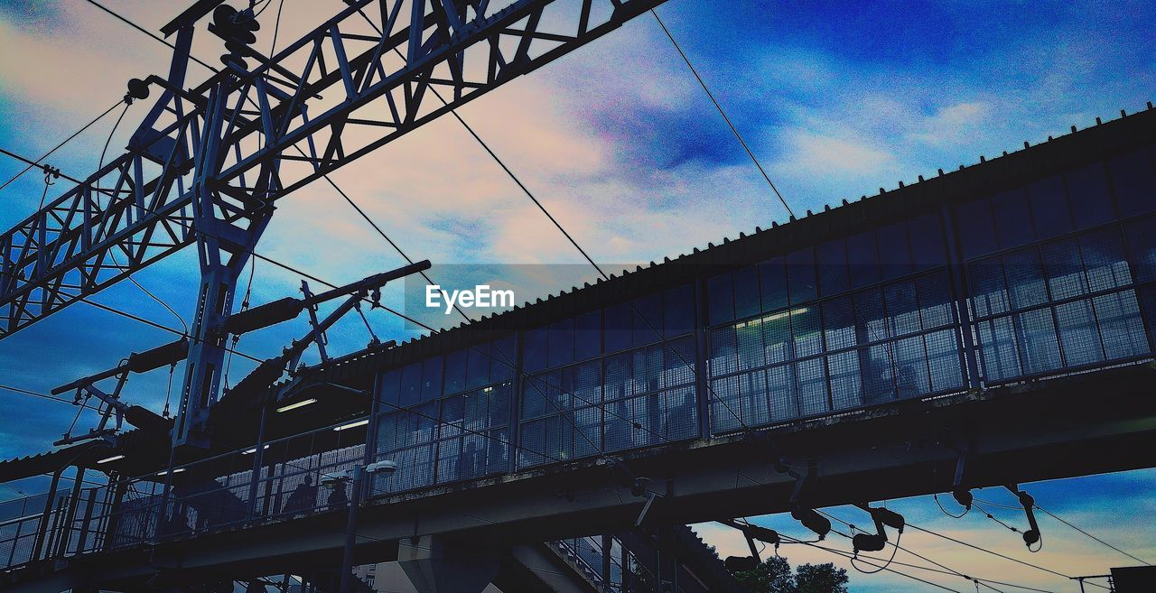 low angle view, architecture, sky, cloud - sky, day, built structure, connection, outdoors, transportation, no people, building exterior