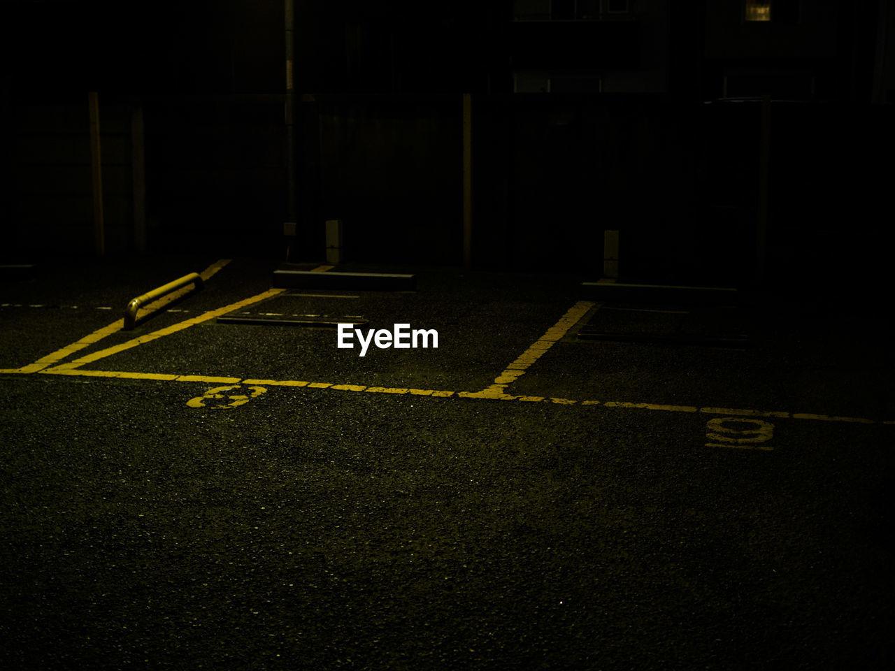 Close-up of road markings at night