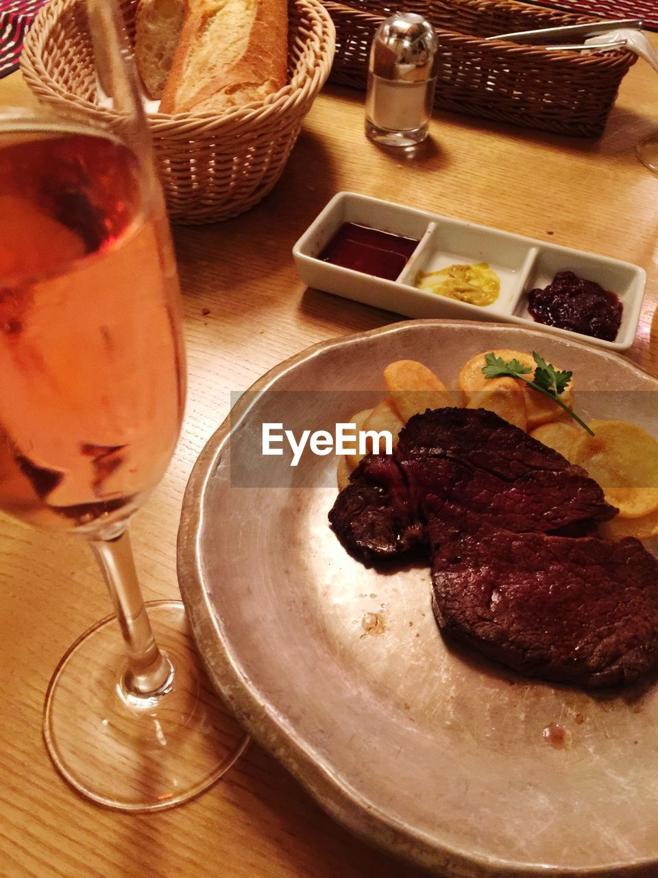 food and drink, drinking glass, food, plate, table, indoors, wine, meat, wineglass, basket, freshness, alcohol, no people, drink, ready-to-eat, meal, close-up, day