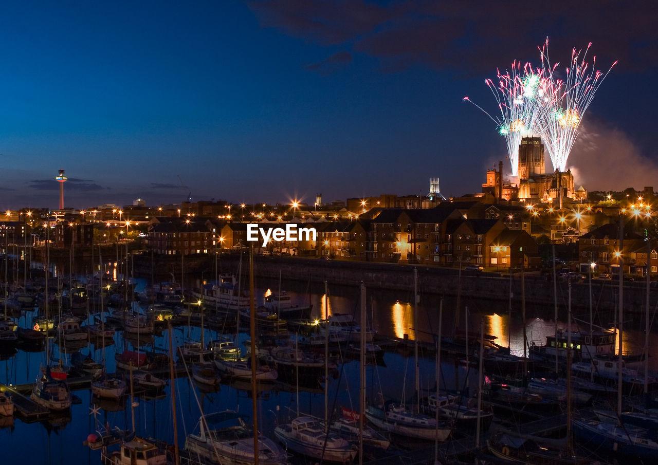 Firework Display, Harbor, And Illuminated City At Night