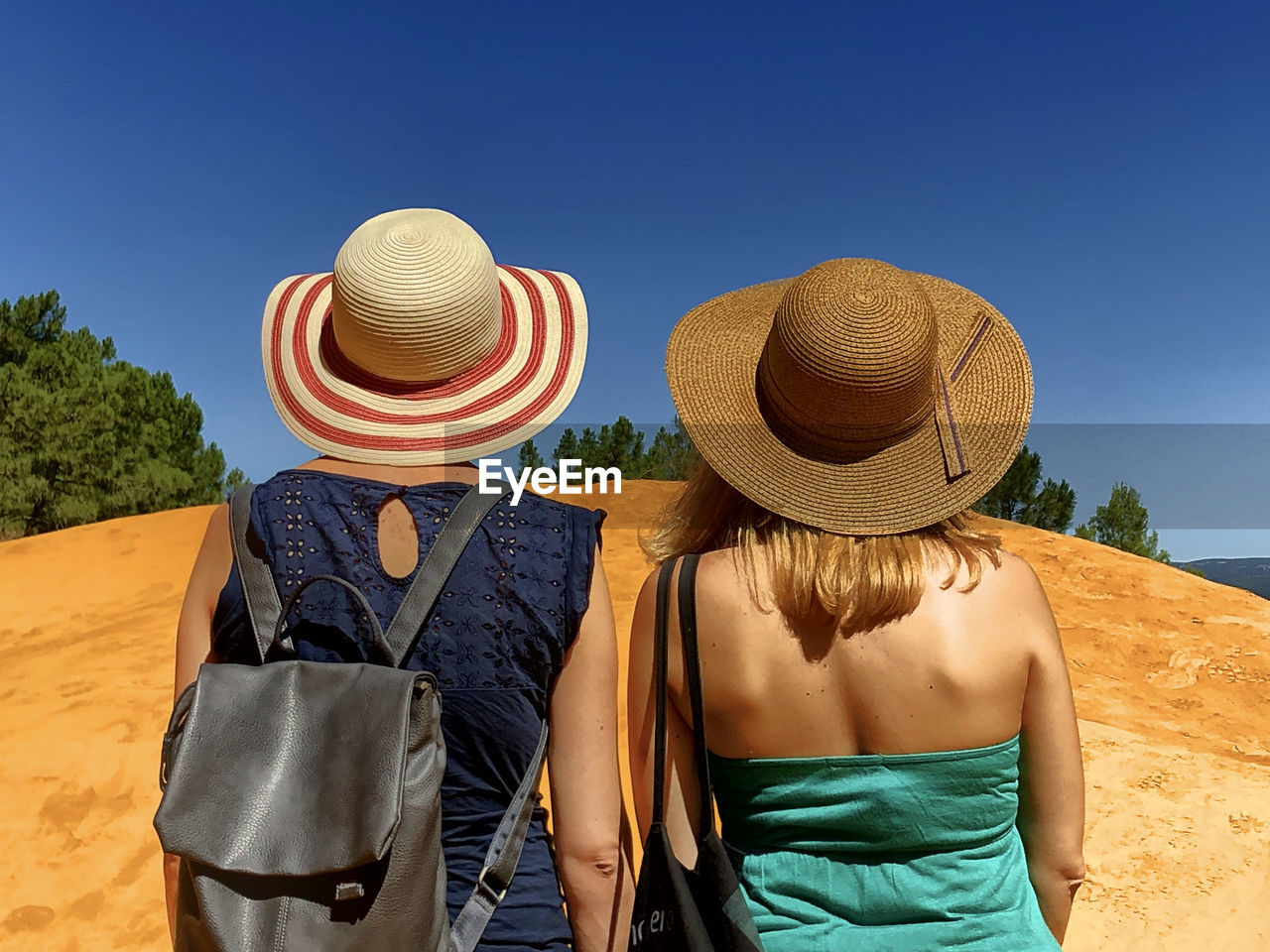 hat, clothing, rear view, sky, nature, real people, adult, sunlight, casual clothing, land, men, women, clear sky, two people, day, leisure activity, blue, straw hat, sun hat, togetherness, outdoors, obscured face