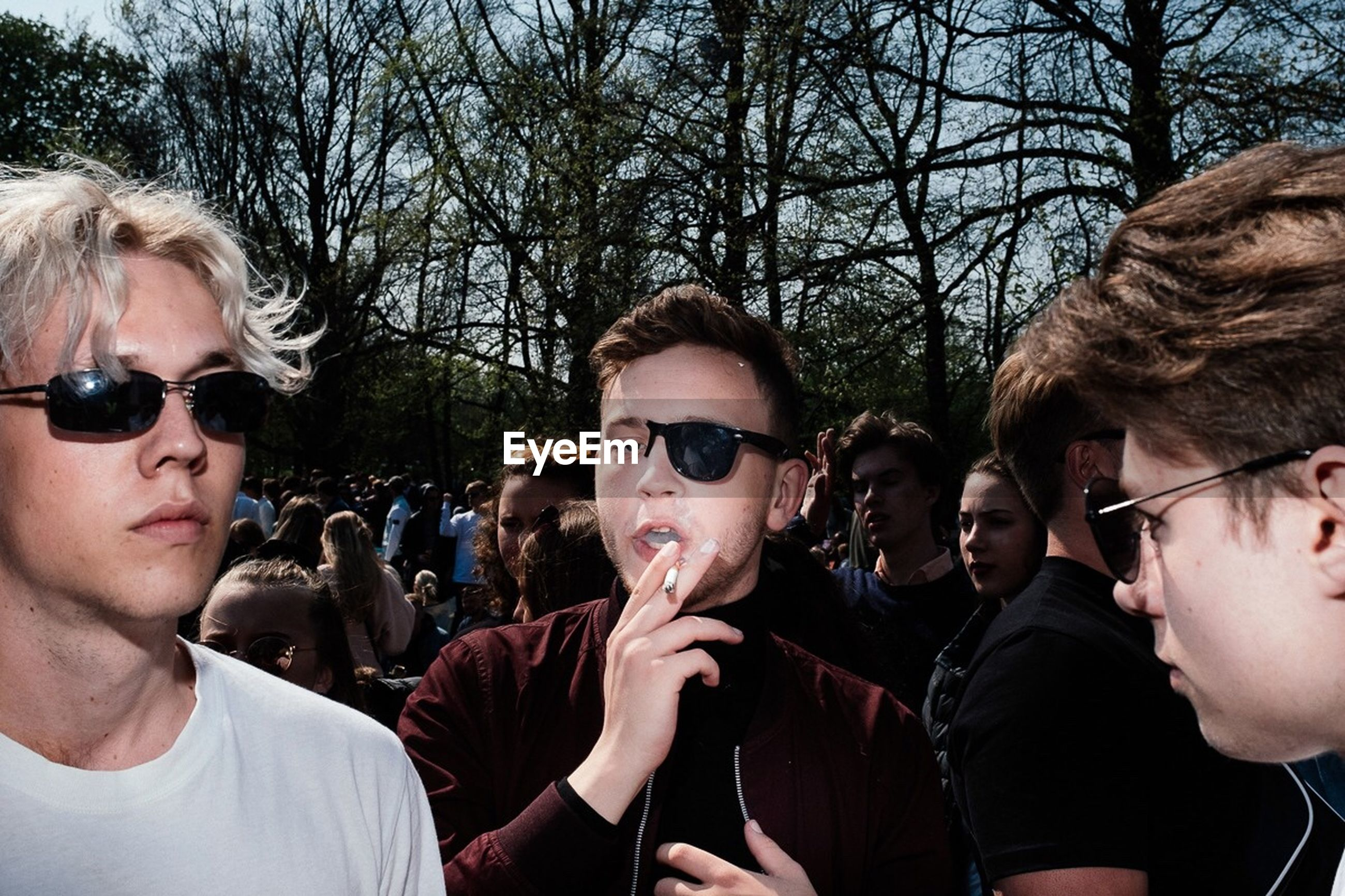 sunglasses, glasses, group of people, real people, fashion, people, crowd, leisure activity, young men, men, tree, portrait, lifestyles, young adult, nature, headshot, togetherness, outdoors, teenager, adolescence