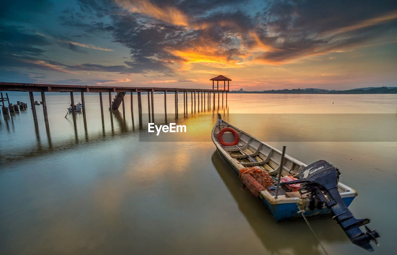 water, sunset, sky, nautical vessel, cloud - sky, transportation, scenics - nature, beauty in nature, tranquility, mode of transportation, sea, tranquil scene, nature, orange color, moored, no people, reflection, pier, idyllic, outdoors, wooden post