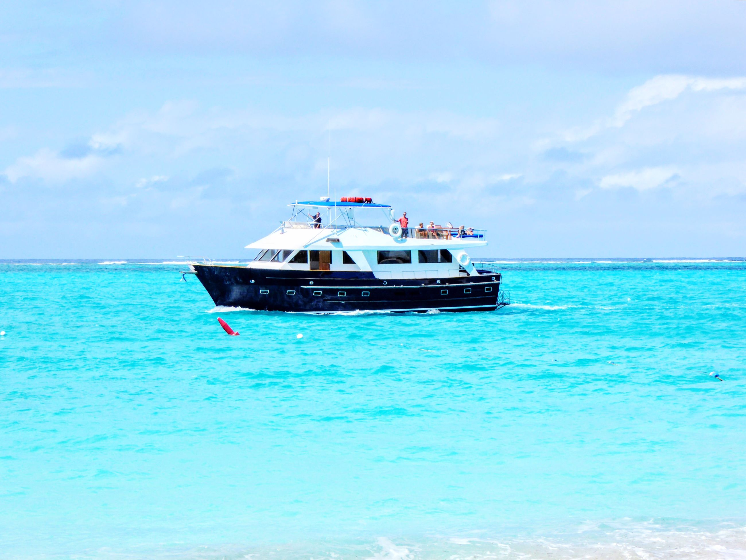 sea, nautical vessel, transportation, mode of transportation, water, sky, travel, nature, day, cloud - sky, beauty in nature, vacations, sailing, turquoise colored, holiday, trip, craft, yacht, blue, outdoors, luxury, horizon over water, no people, passenger craft, cruise ship