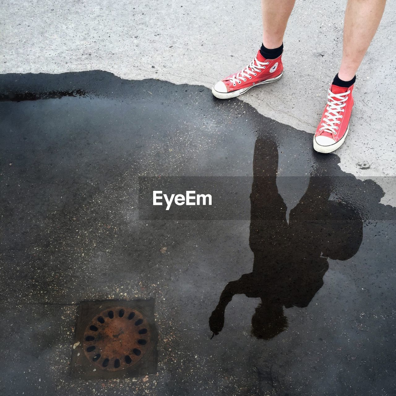 low section, outdoors, shoe, human leg, high angle view, human body part, day, standing, water, one person, puddle, close-up, people, adult