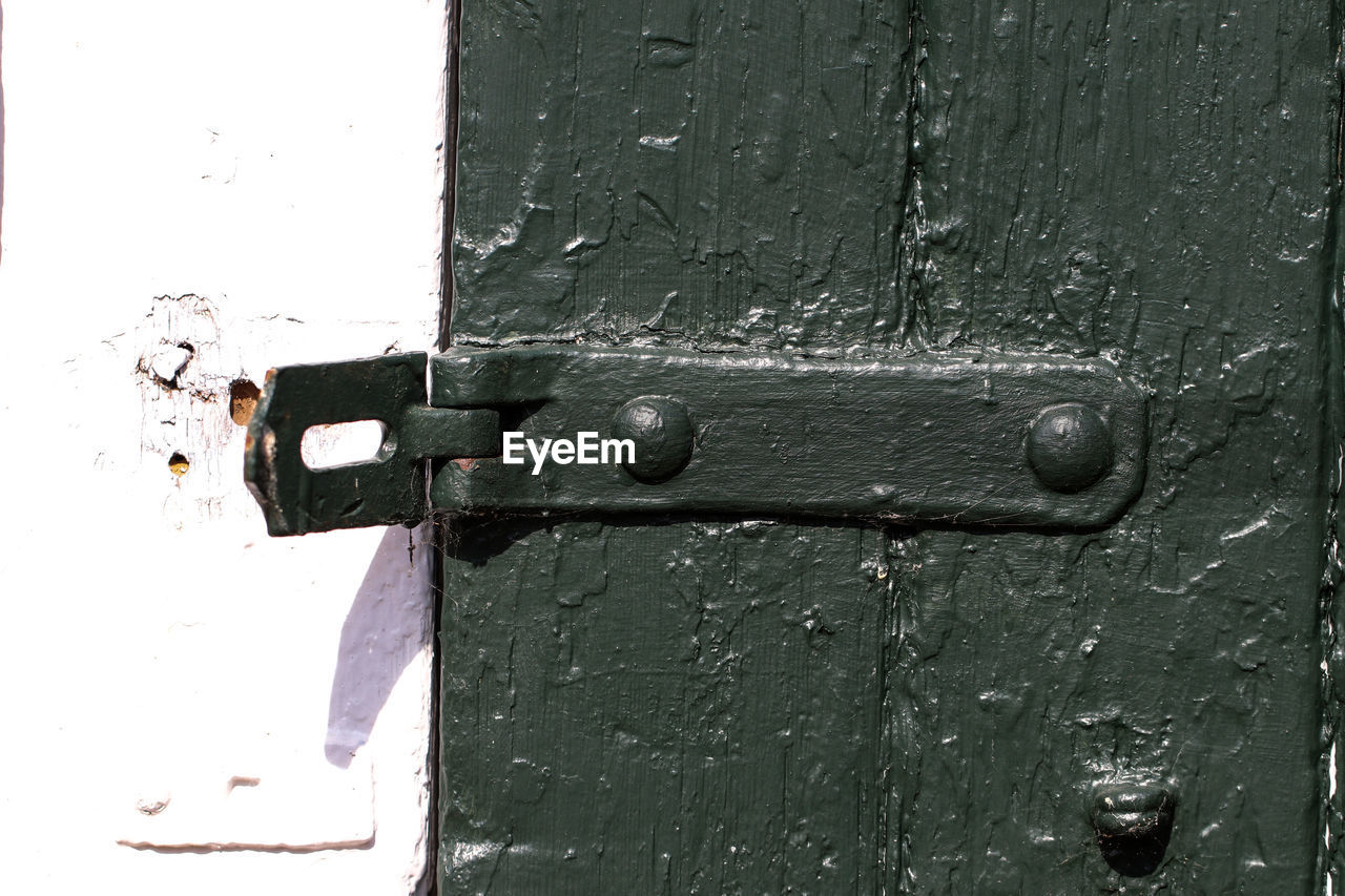 door, entrance, lock, no people, wood - material, protection, close-up, security, old, closed, metal, safety, weathered, day, doorknob, handle, outdoors, backgrounds, latch, knob, deterioration