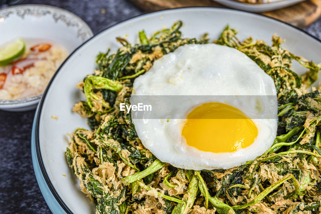 food, food and drink, healthy eating, wellbeing, ready-to-eat, plate, egg, freshness, close-up, fried, fried egg, no people, still life, indoors, meal, egg yolk, serving size, high angle view, table, vegetable, sunny side up, breakfast, temptation