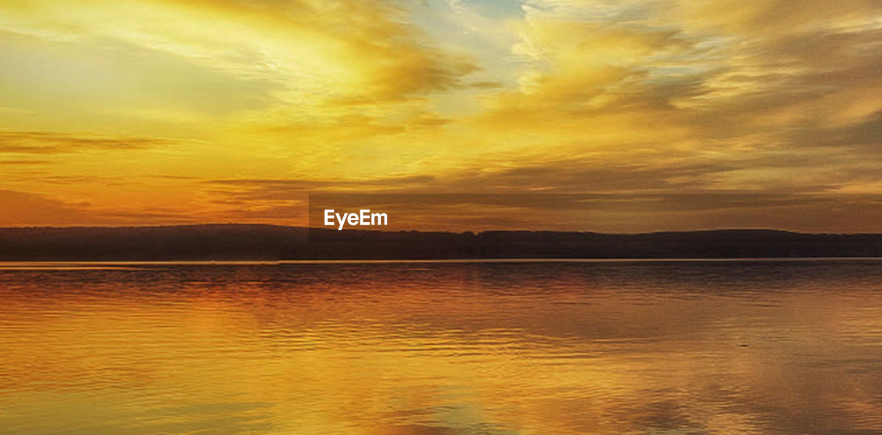 water, sky, sunset, beauty in nature, scenics - nature, reflection, sea, tranquility, cloud - sky, nature, tranquil scene, no people, dramatic sky, environment, idyllic, outdoors, landscape, majestic, horizon over water, lagoon