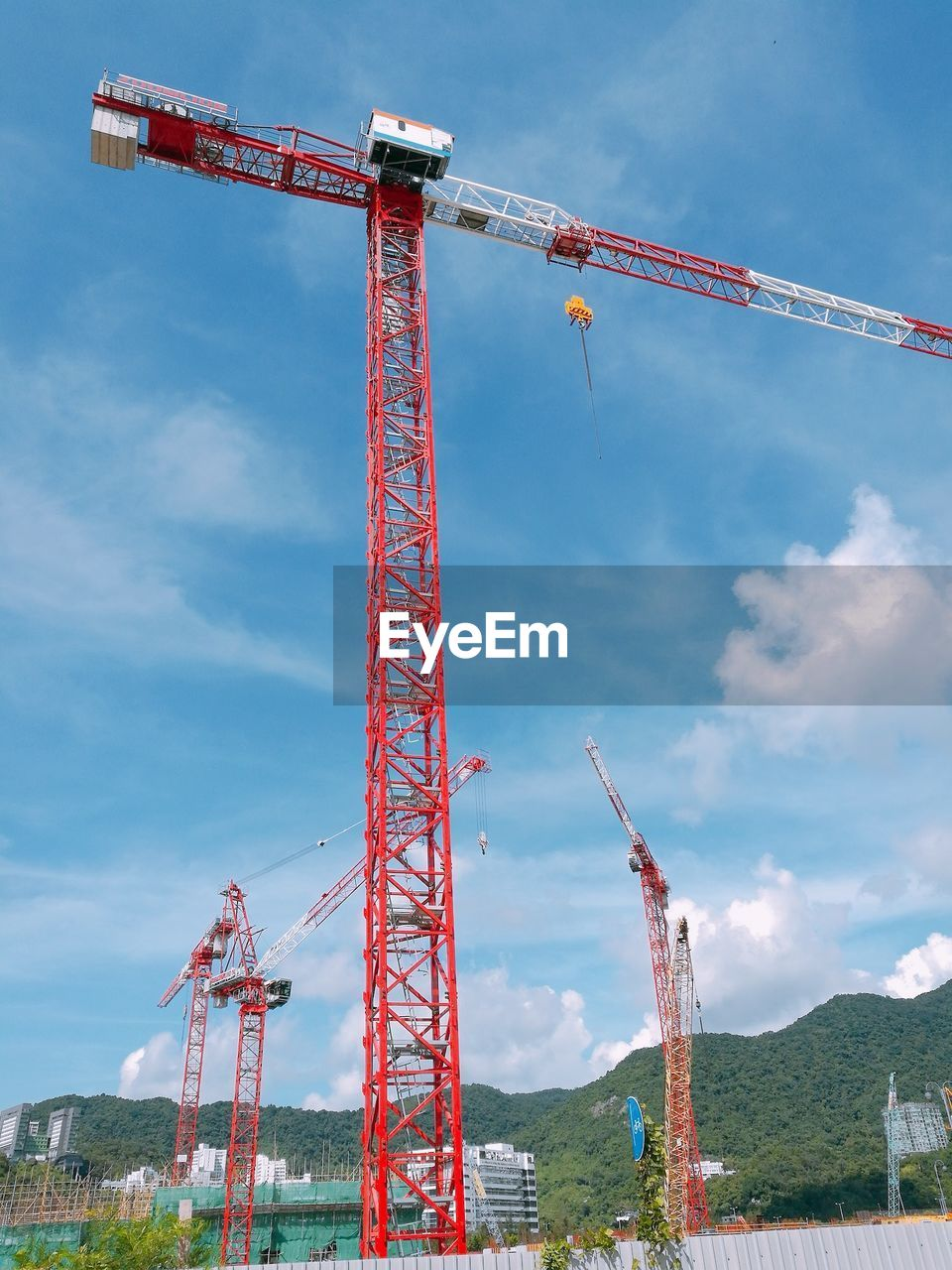 sky, machinery, crane - construction machinery, industry, cloud - sky, construction industry, red, nature, construction site, low angle view, day, architecture, development, tall - high, no people, built structure, metal, outdoors, construction machinery, incomplete, construction equipment