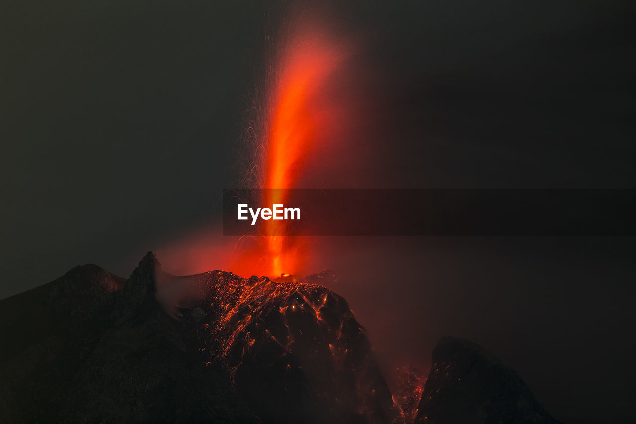 Lava Erupting From Mountain At Night
