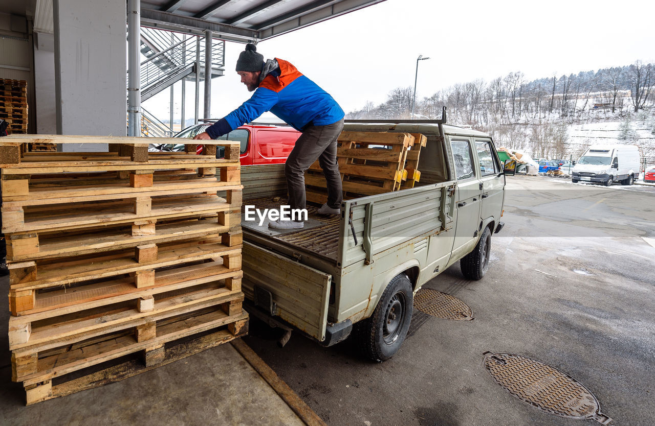 Man Loading Luggage In Truck