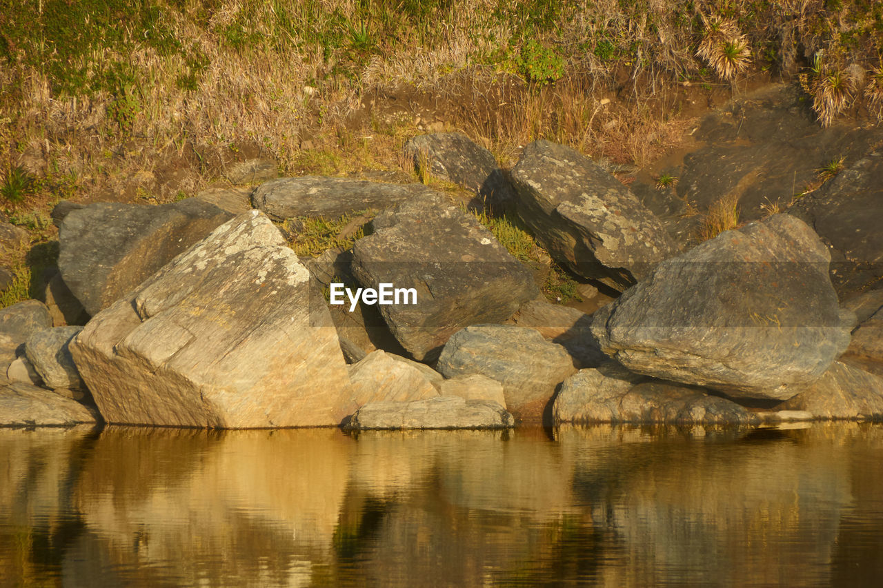 rock, water, rock - object, solid, reflection, lake, nature, tranquility, waterfront, beauty in nature, no people, rock formation, tranquil scene, scenics - nature, outdoors, day, land, non-urban scene, shallow