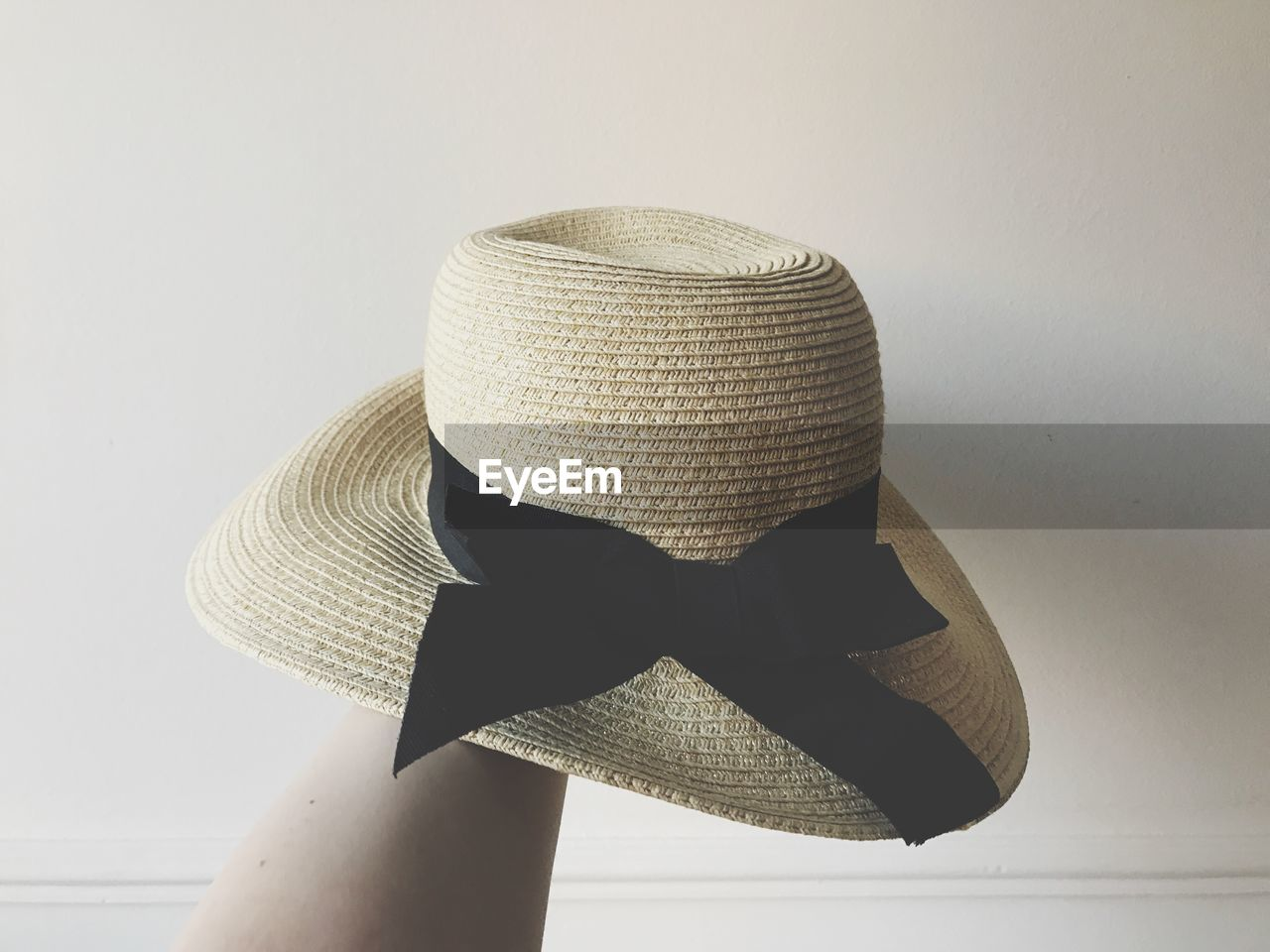 hat, clothing, indoors, sun hat, white background, still life, straw hat, protection, no people, close-up, security, wall - building feature, studio shot, fashion, ribbon, bow, high angle view, personal accessory, tied bow, headwear