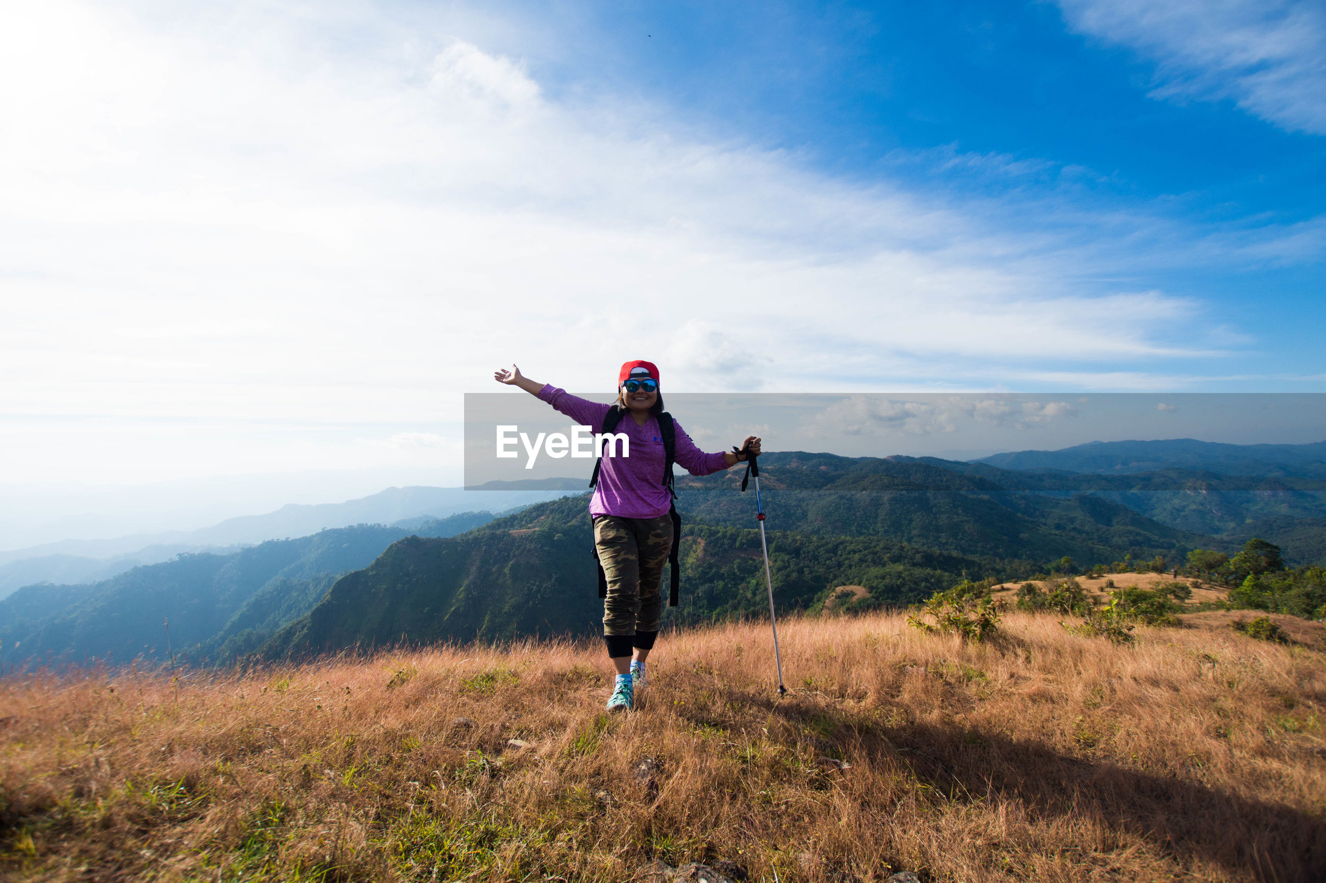 Full length of woman on mountain against sky