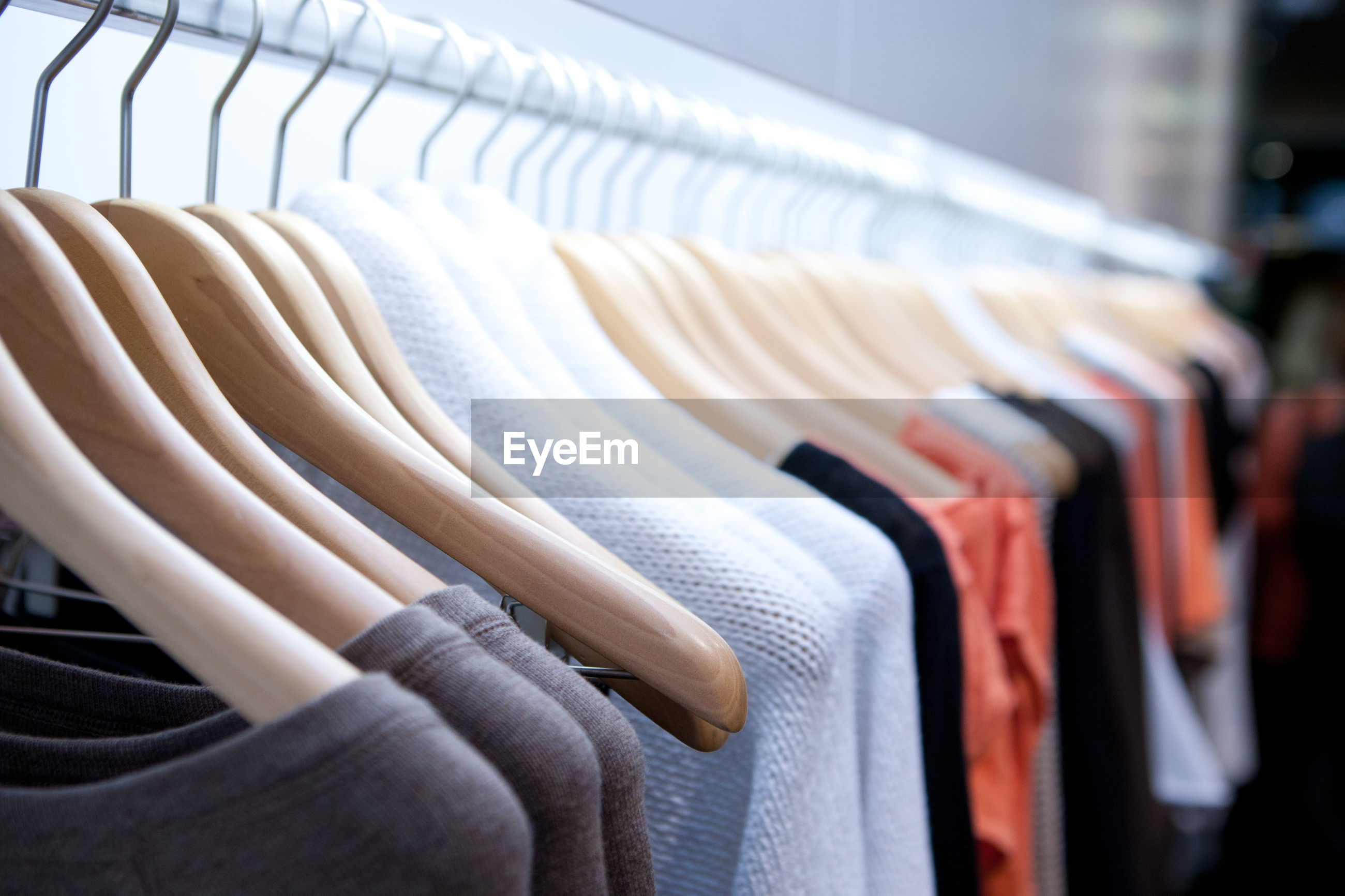 Clothes drying on rack at store