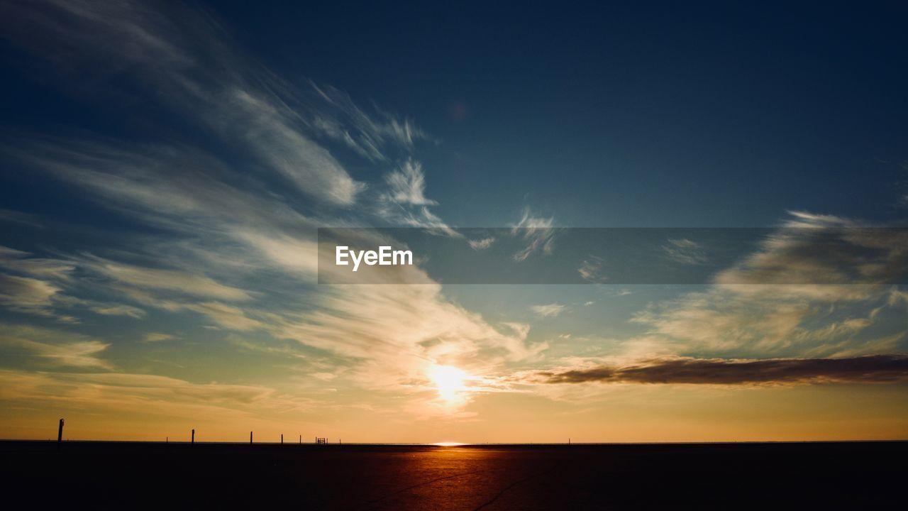 sky, sunset, cloud - sky, beauty in nature, scenics - nature, tranquil scene, tranquility, silhouette, nature, orange color, no people, horizon, idyllic, environment, water, sun, non-urban scene, sunlight, sea, outdoors