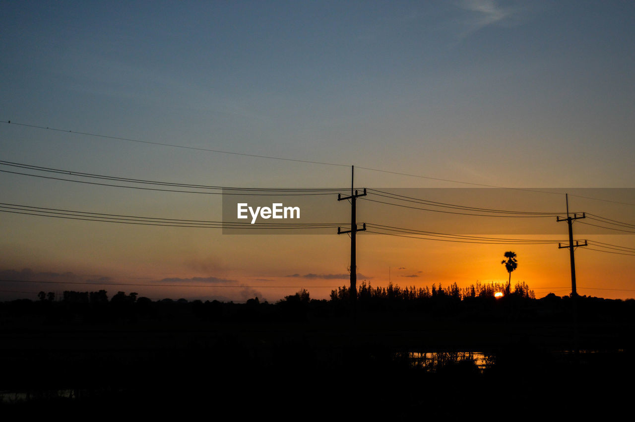 silhouette, sky, sunset, electricity, cable, technology, power line, electricity pylon, connection, power supply, beauty in nature, no people, orange color, nature, fuel and power generation, tranquility, tranquil scene, tree, scenics - nature, landscape, outdoors, telephone line, dark