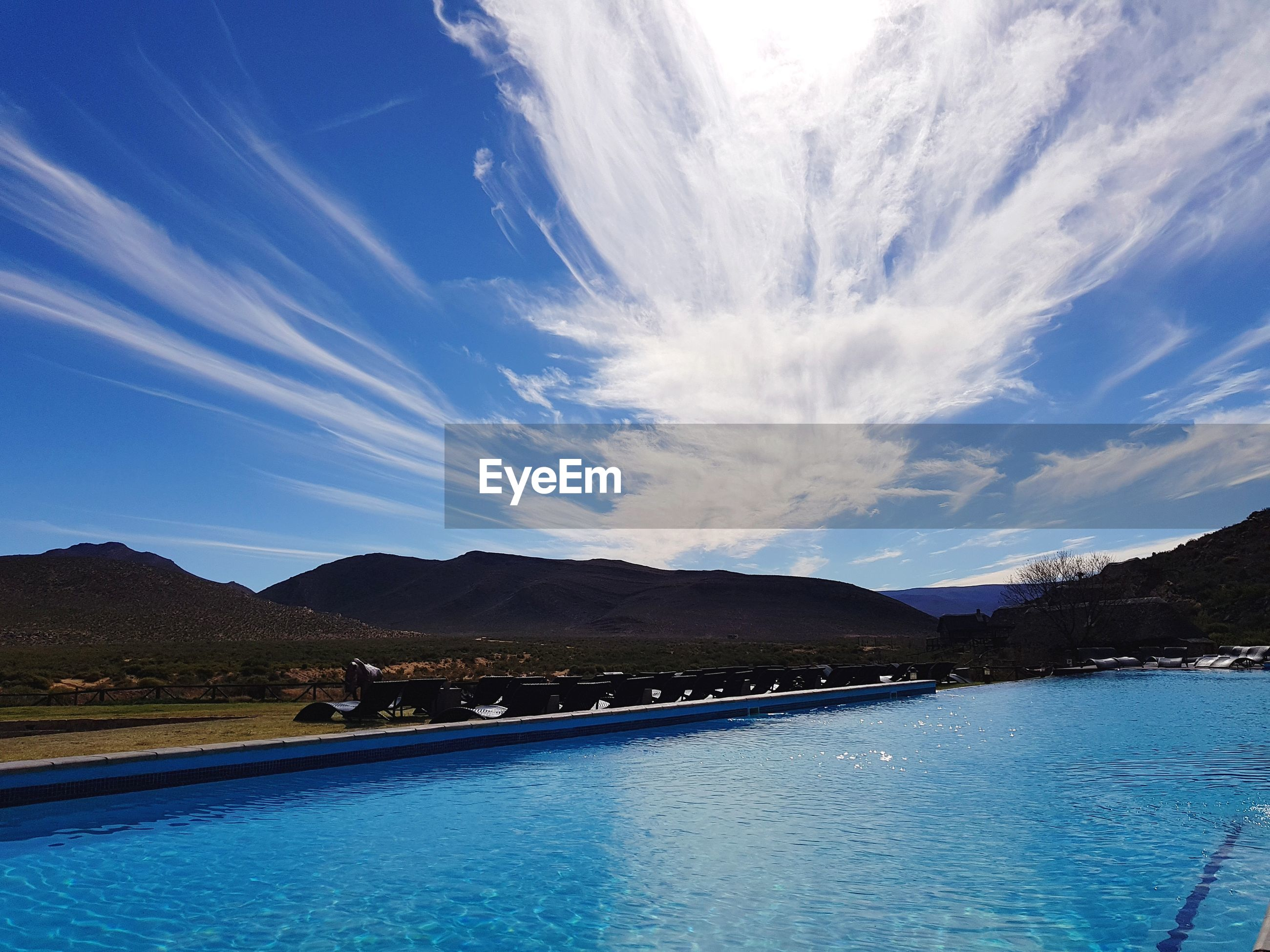 SCENIC VIEW OF SWIMMING POOL AGAINST SKY