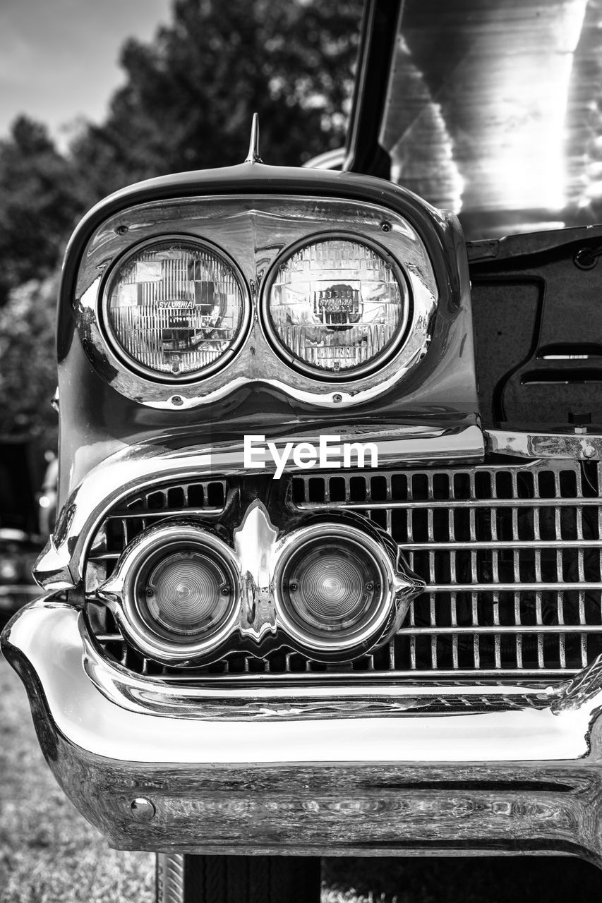 mode of transport, transportation, headlight, land vehicle, old-fashioned, close-up, car, retro styled, day, outdoors, no people, sky
