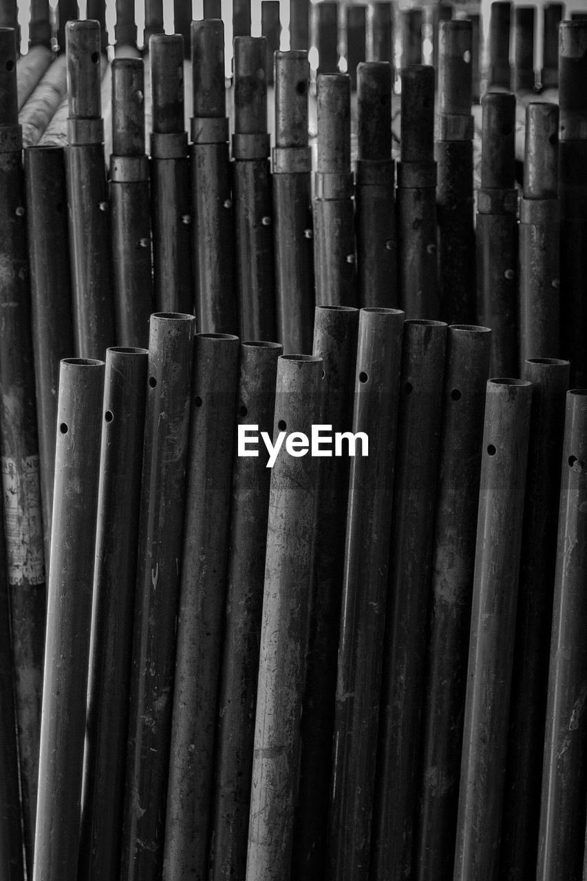 no people, full frame, backgrounds, large group of objects, side by side, close-up, bamboo - material, indoors, still life, repetition, abundance, bamboo, in a row, pattern, wood - material, day, order, stack, arrangement, focus on foreground, bamboo - plant