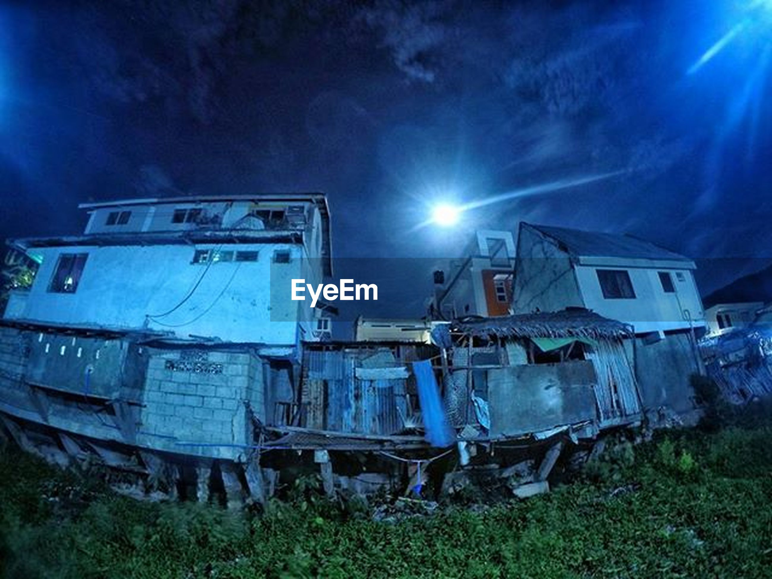 abandoned, transportation, damaged, obsolete, mode of transport, run-down, sky, built structure, deterioration, blue, old, field, architecture, building exterior, sunlight, land vehicle, no people, grass, outdoors, cloud - sky