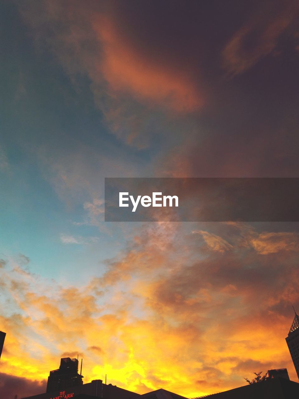 cloud - sky, sky, sunset, orange color, beauty in nature, scenics - nature, nature, low angle view, no people, architecture, building exterior, built structure, tranquil scene, outdoors, silhouette, tranquility, dramatic sky, idyllic, building