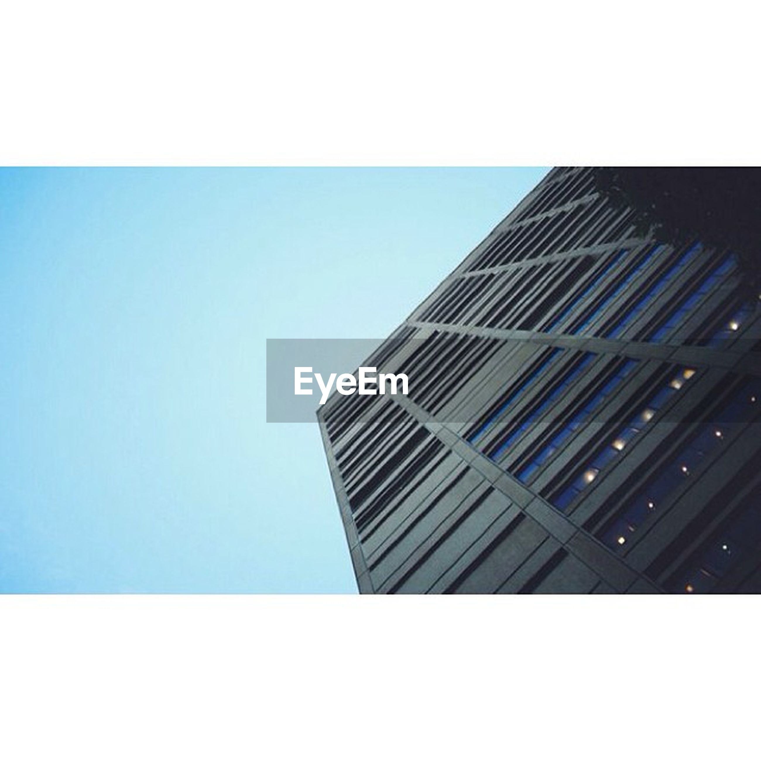 building exterior, architecture, built structure, low angle view, clear sky, office building, modern, skyscraper, tall - high, city, tower, transfer print, copy space, building, auto post production filter, blue, tall, glass - material, day, sky