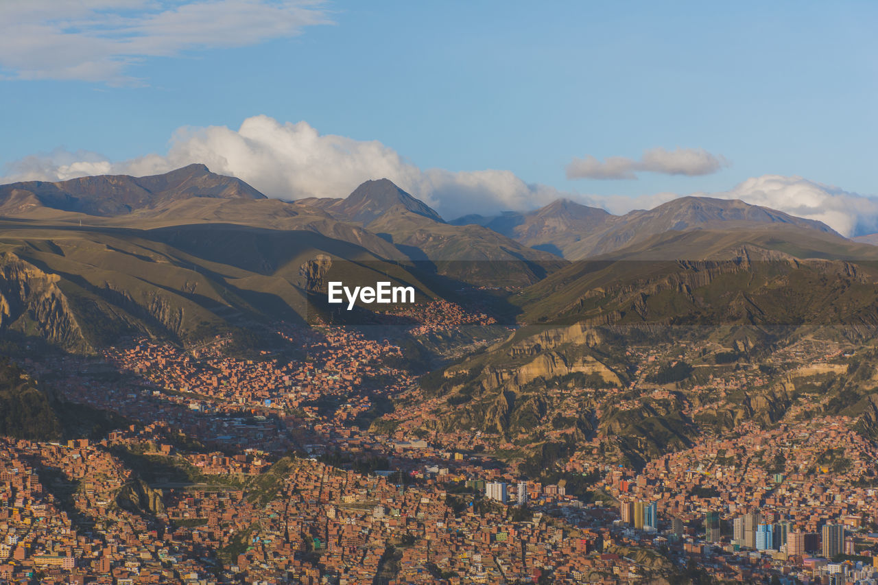 Scenic View Of City With Mountains In Background