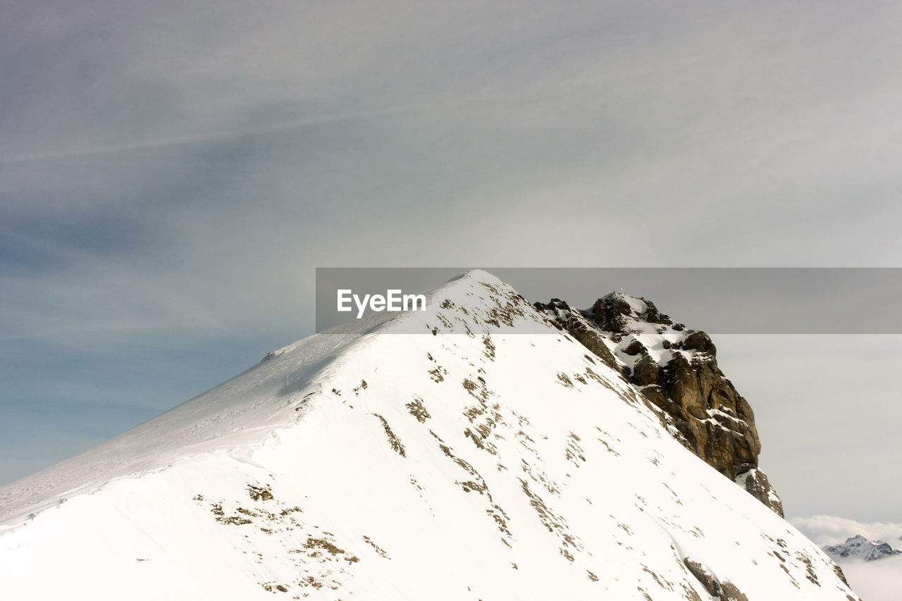Scenic View Of Snowcapped Mountain Against Sky