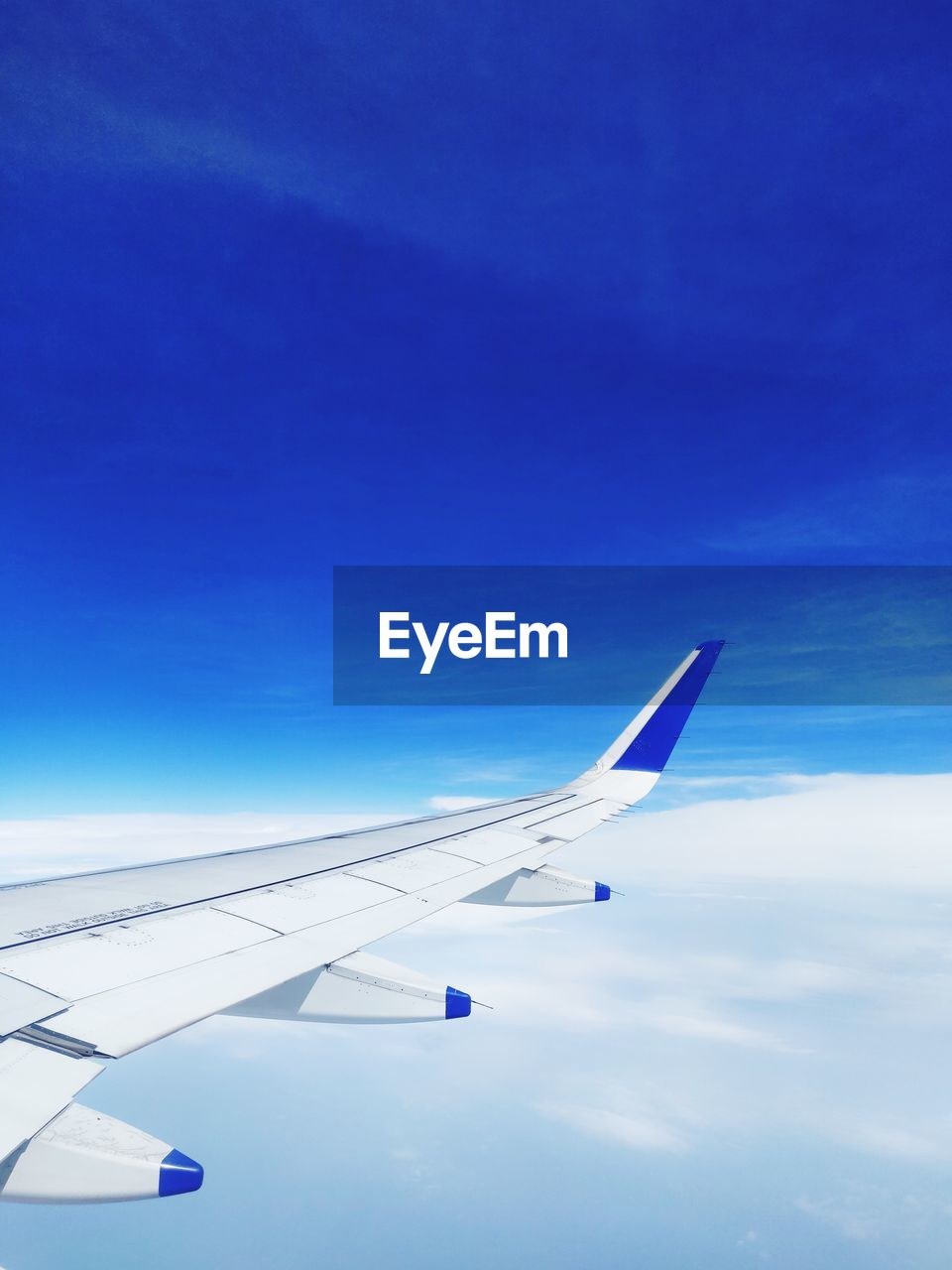 airplane, sky, air vehicle, aircraft wing, transportation, mode of transportation, cloud - sky, travel, flying, blue, no people, nature, journey, day, mid-air, on the move, beauty in nature, scenics - nature, motion, outdoors, aerospace industry, meteorology
