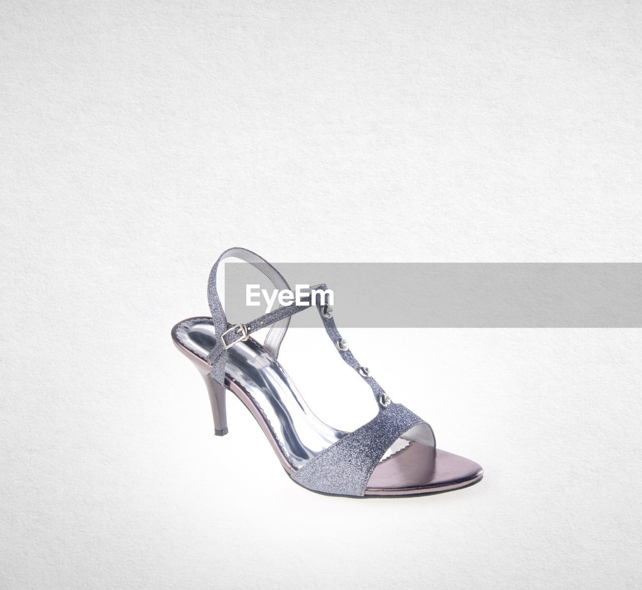 Close-up of high heels over white background