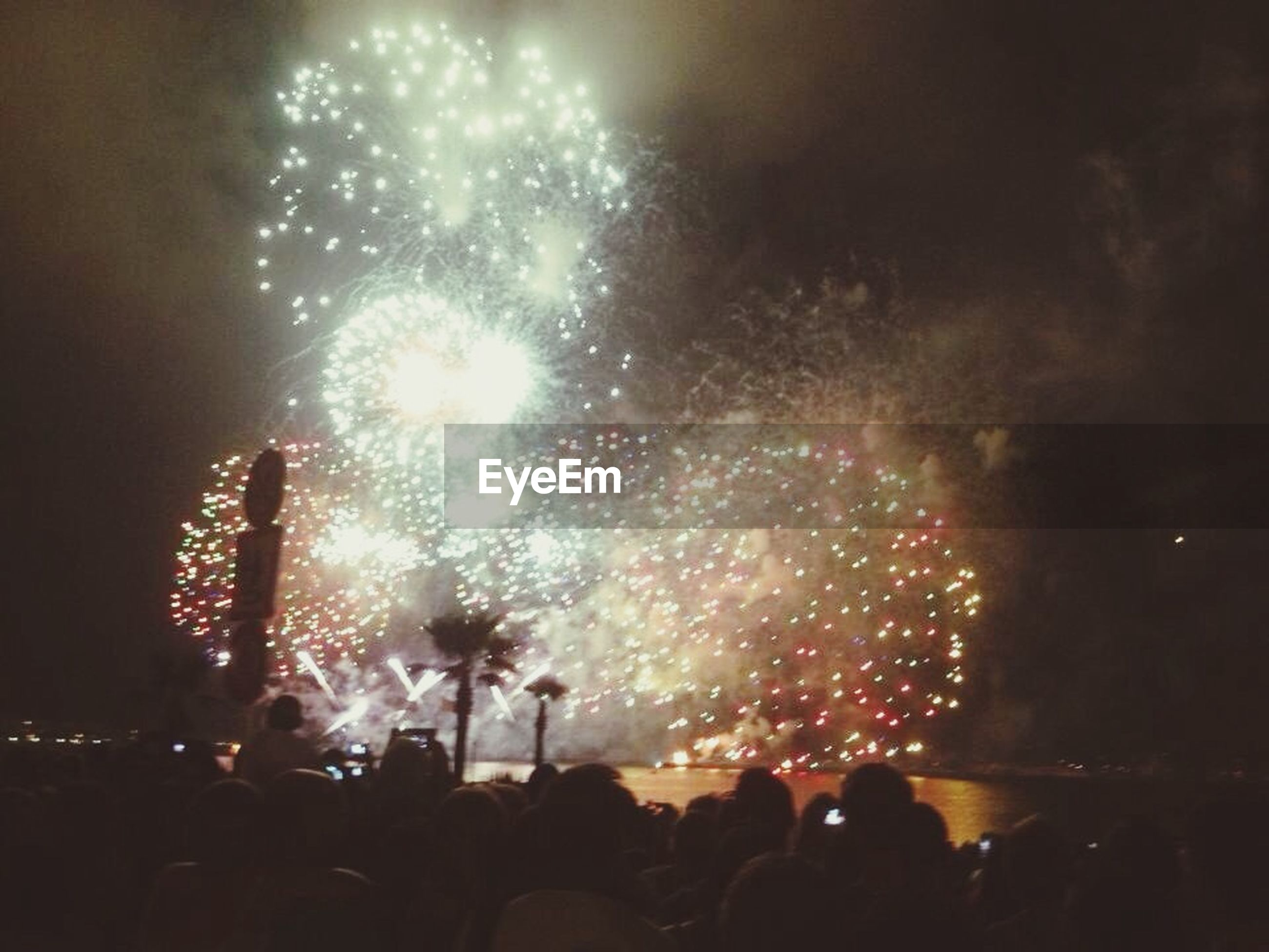 illuminated, event, large group of people, arts culture and entertainment, night, celebration, crowd, firework display, enjoyment, lifestyles, exploding, firework - man made object, leisure activity, person, men, nightlife, fun, music festival
