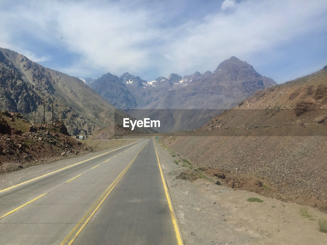 mountain, road, direction, transportation, symbol, scenics - nature, the way forward, sign, mountain range, road marking, sky, non-urban scene, diminishing perspective, marking, landscape, beauty in nature, tranquil scene, nature, tranquility, no people, outdoors, dividing line, long