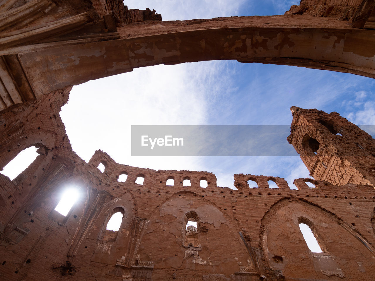 history, architecture, the past, sky, ancient, arch, built structure, old ruin, travel, tourism, travel destinations, damaged, low angle view, nature, old, bad condition, no people, abandoned, ruined, day, archaeology, ancient civilization, outdoors, deterioration, architectural column, arched