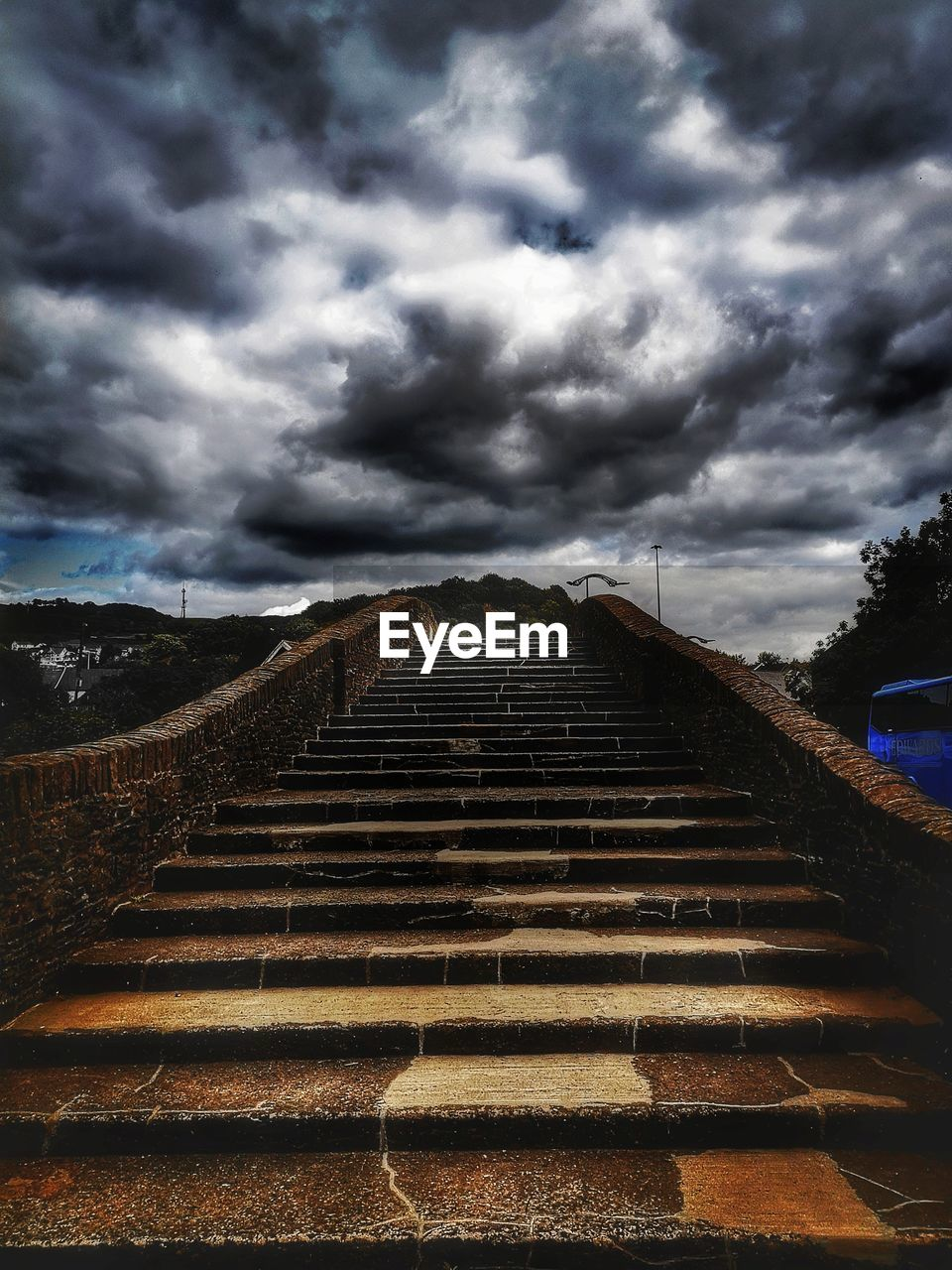 cloud - sky, sky, direction, the way forward, architecture, staircase, nature, no people, built structure, steps and staircases, day, railing, outdoors, transportation, overcast, diminishing perspective, storm cloud, low angle view, storm, long, ominous