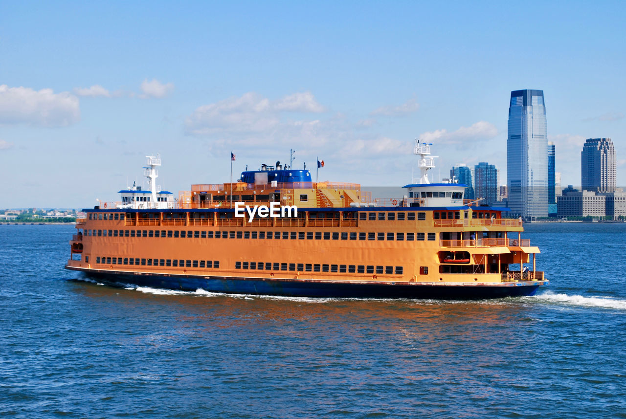 transportation, waterfront, mode of transport, nautical vessel, water, sky, day, sea, outdoors, architecture, no people, cloud - sky, nature, cityscape, skyscraper, built structure, building exterior, urban skyline, beauty in nature, city
