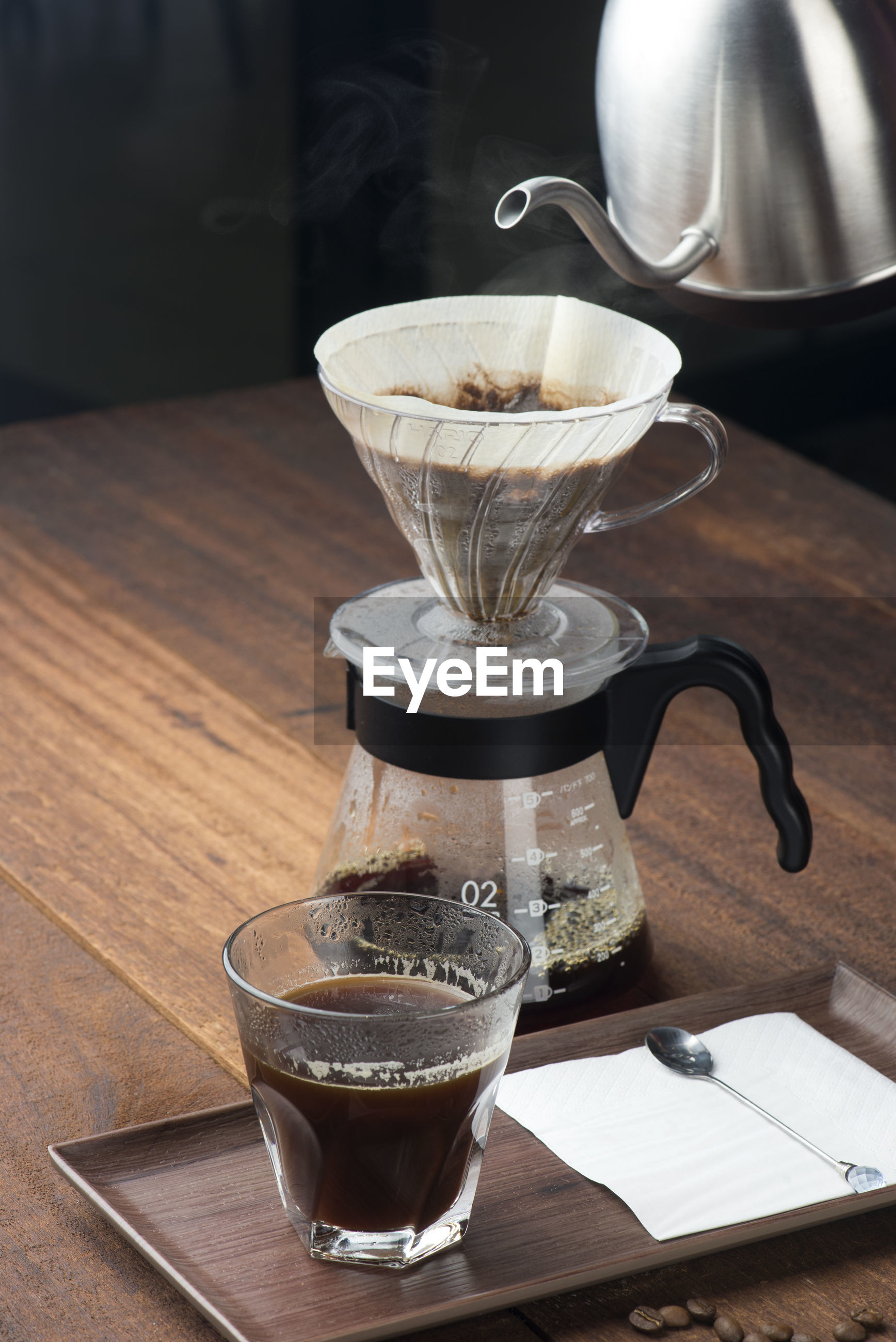Coffee filter and drinking glass on table