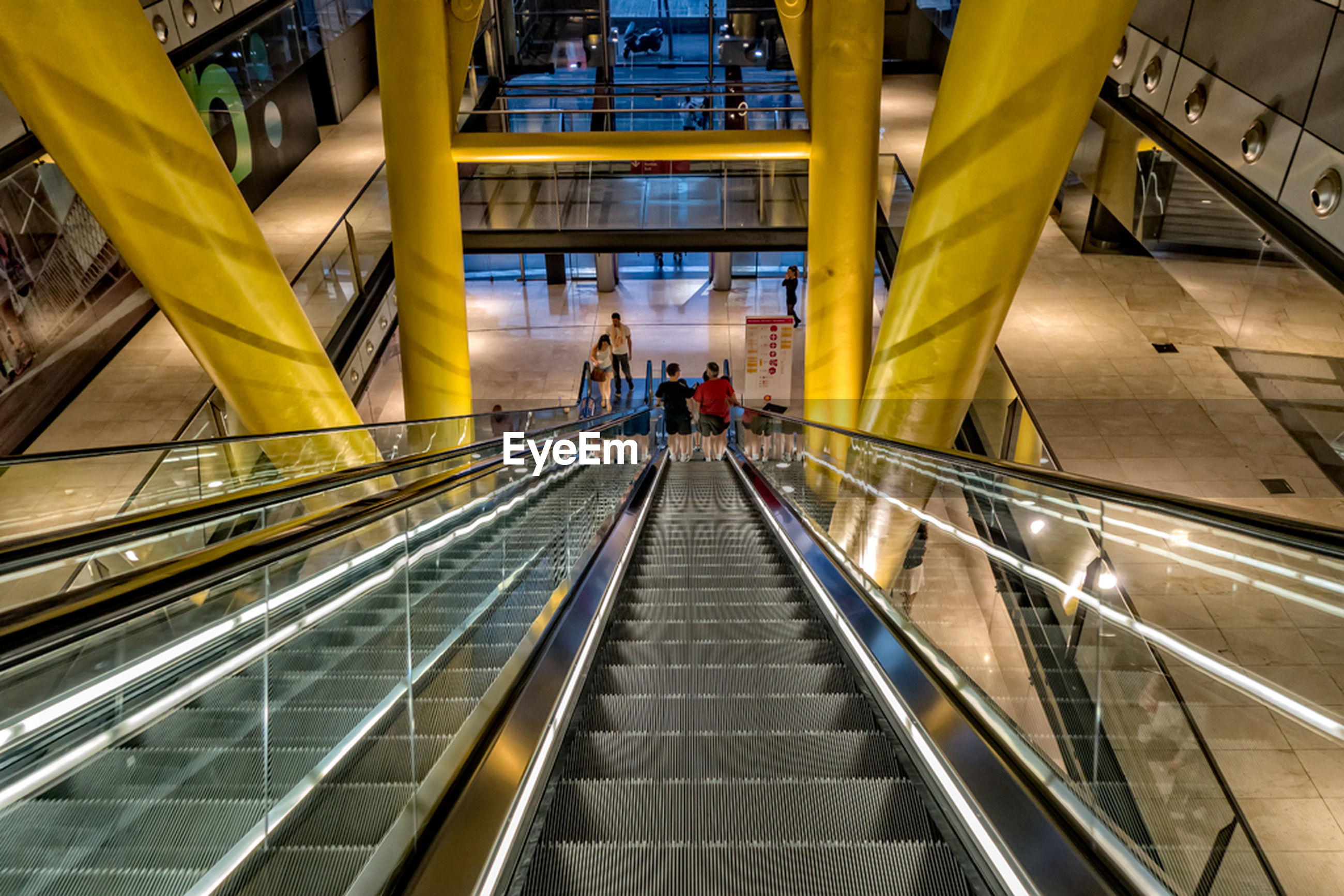 High angle view of escalator moving down in mall