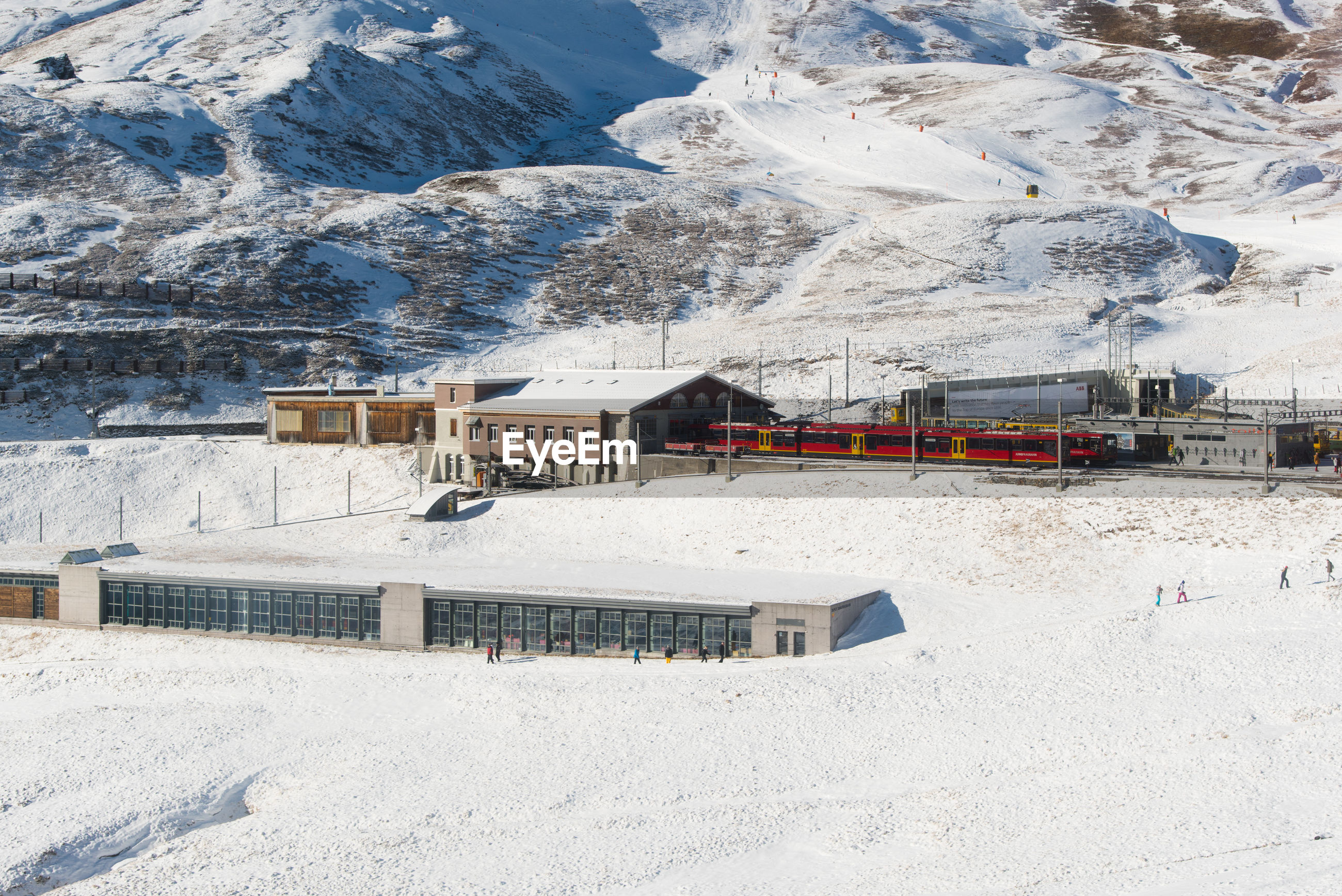 Railroad station by snowcapped mountain