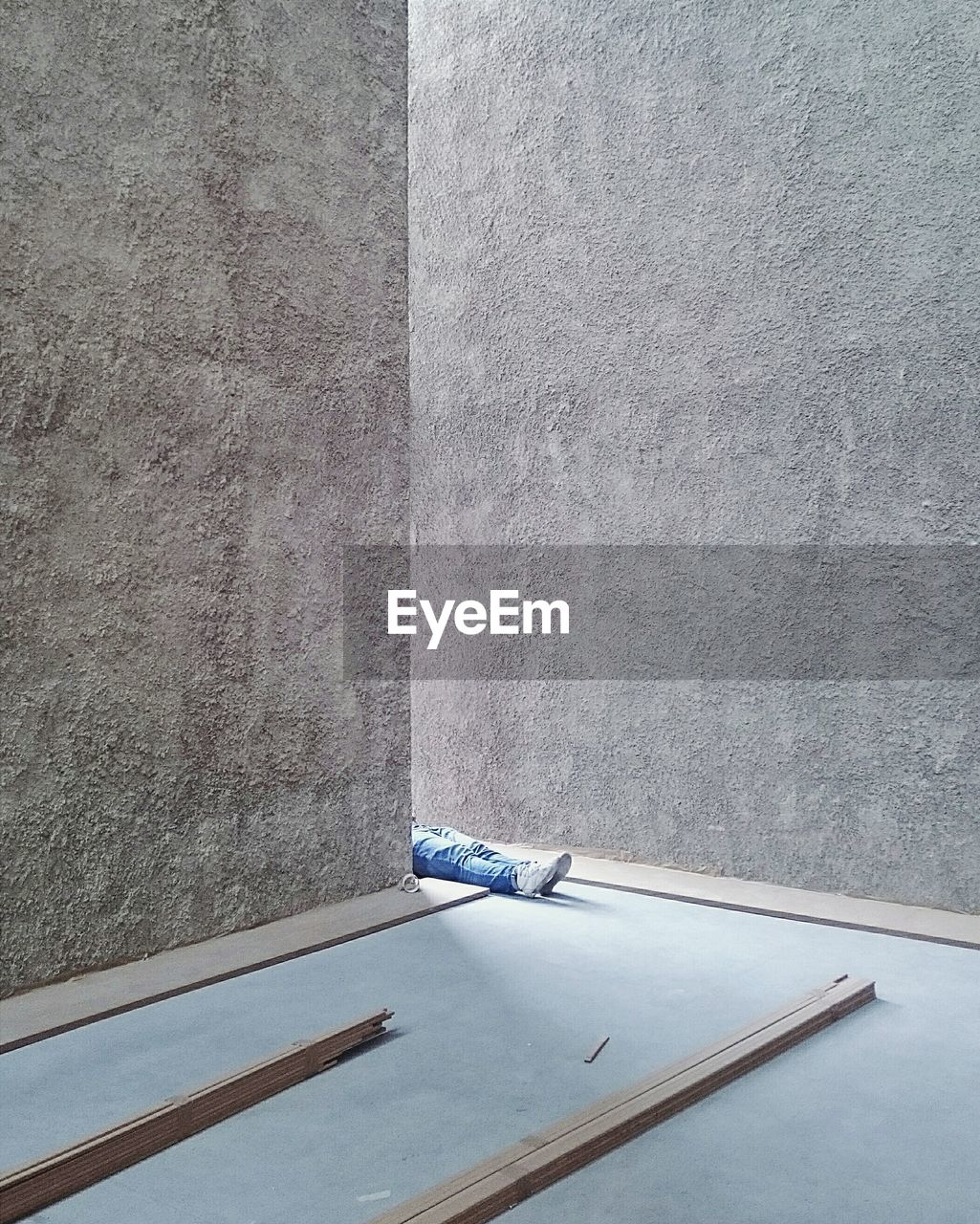 Low Section Of Person Amidst Concrete Walls