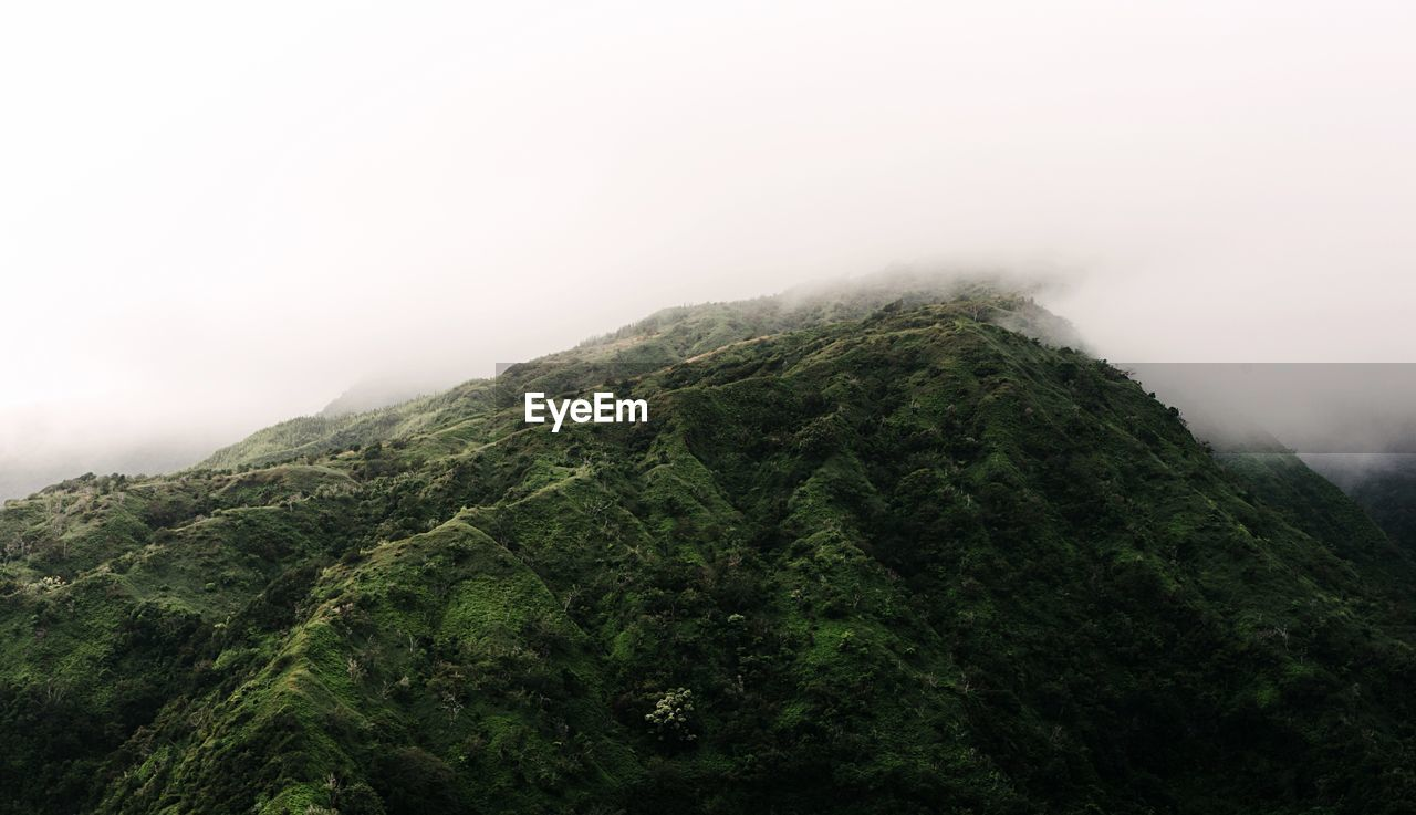 Low angle view of mountain during foggy weather
