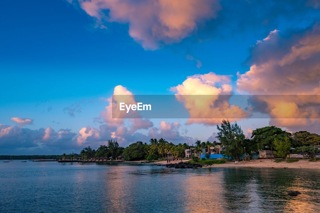 sky, water, cloud - sky, waterfront, beauty in nature, scenics - nature, tranquil scene, tranquility, no people, tree, nature, sea, plant, outdoors, day, non-urban scene, architecture, idyllic, built structure