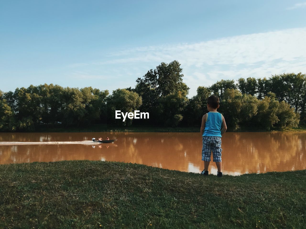 Full Length Of Boy Looking At River
