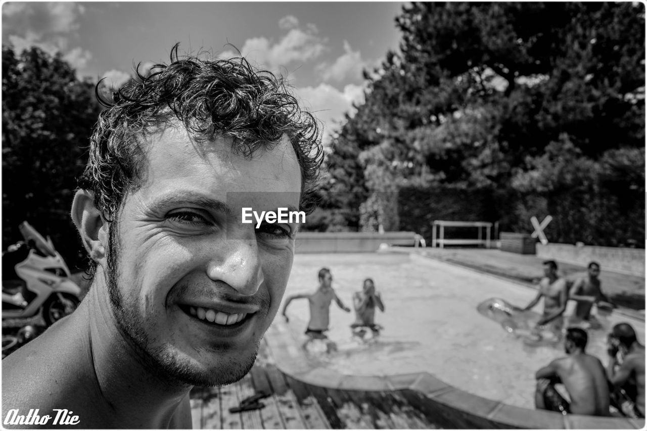 real people, incidental people, smiling, one person, portrait, looking at camera, outdoors, leisure activity, headshot, happiness, day, fun, swimming pool, lifestyles, skateboard park, tree, sky, young adult, close-up, people